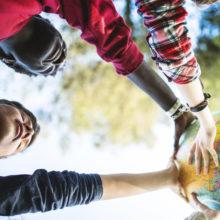 teenagers holding a globe