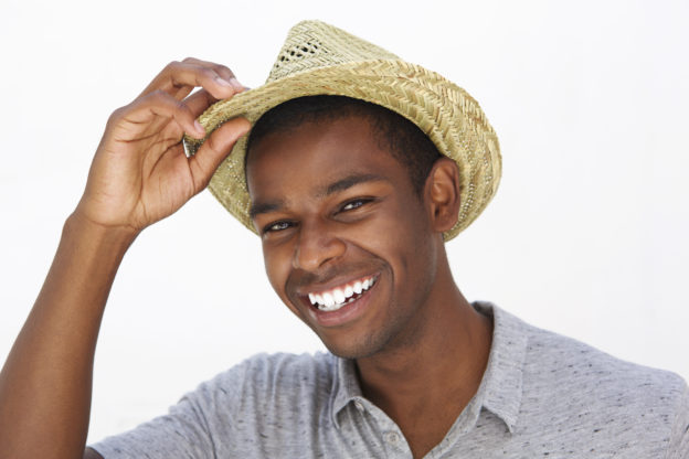 Happy fashionable man smiling with good skin