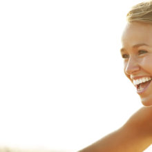 young woman smiling no makeup
