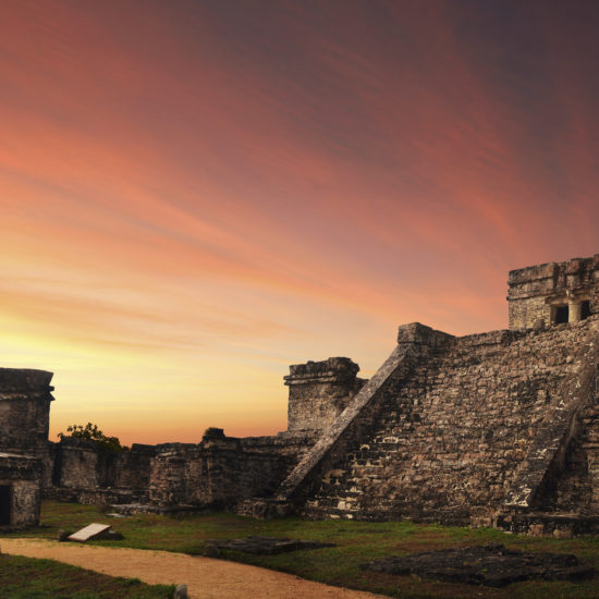 Castillo fortress at sunset in ancient Mayan city of Tulum,