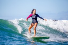 Woman Surfing - Surfing is a Growing Wellness Trend