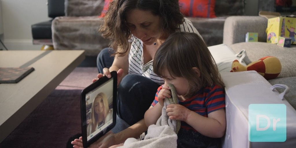 mom and toddler talking with doctor on demand on a tablet