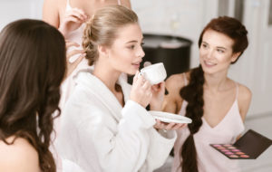 Bride and bridesmaids relaxing