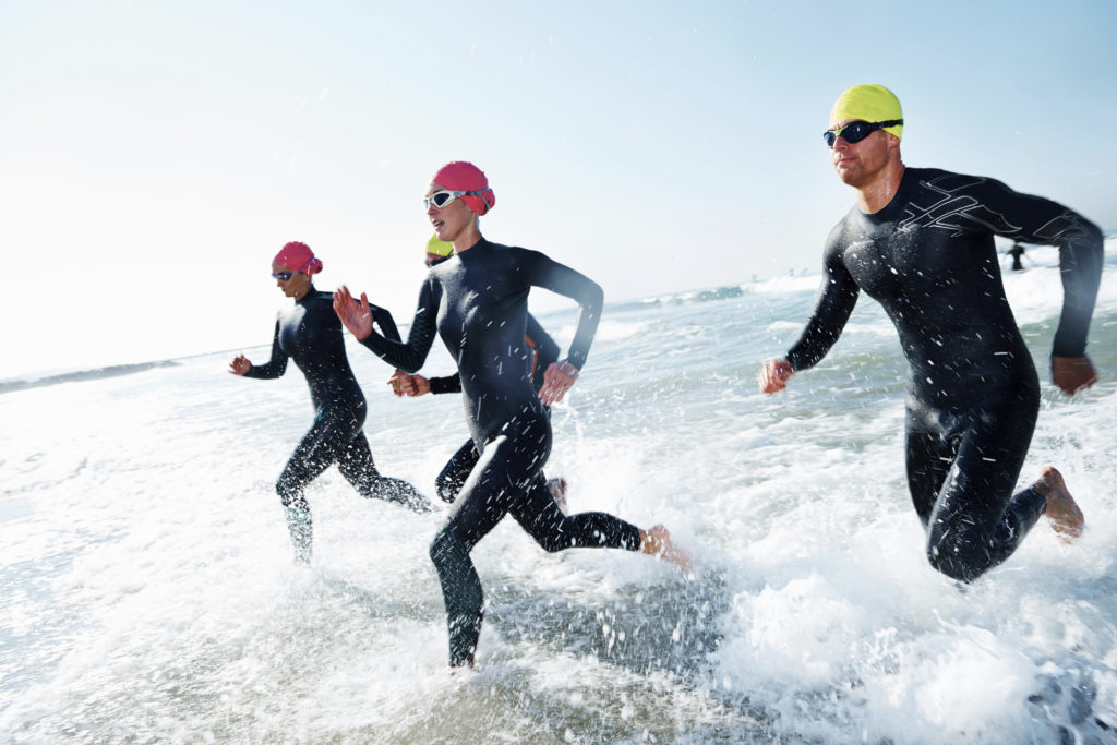 A group of athletes competing in a triathlon