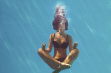 woman meditating under water