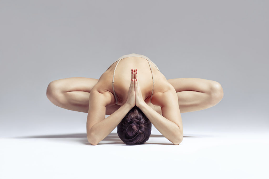 yoga woman posing like a pretzel
