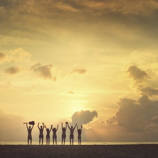 group at the beach sun