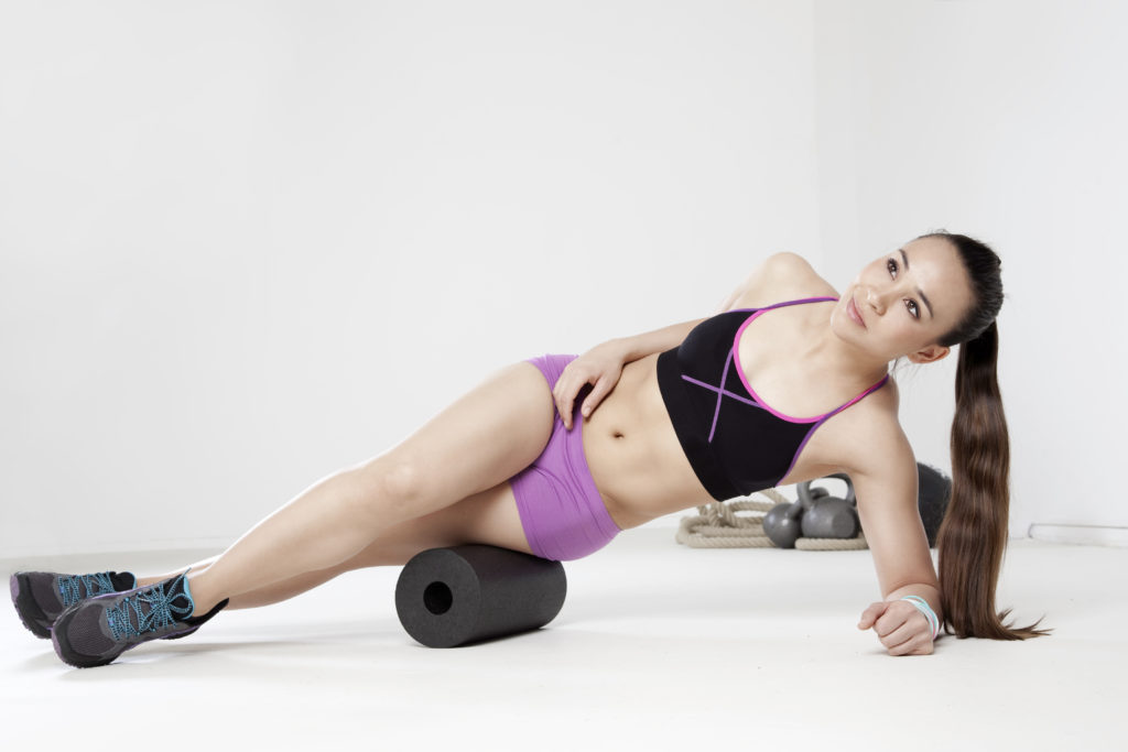 woman using a foam roller