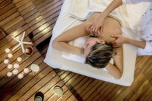 woman on massage table receiving ayurvedic massage