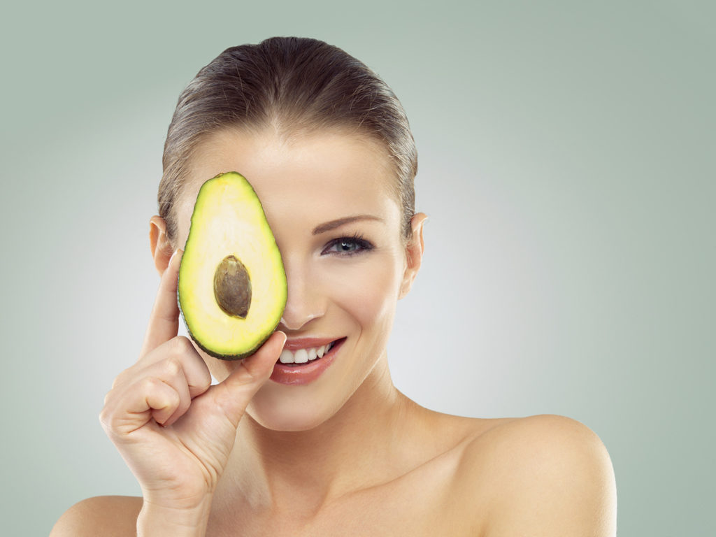 Studio portrait of a beautiful young woman holding half an avocado in front of her facehttp://azarubaika.com/iStockphoto/2014_05_09_Victoria_Beauty.jpg