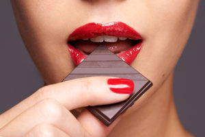 Nutrition: Aphrodisiacs - Woman Eating Chocolate