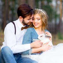 Rustic Wedding - Couple caressing a bunny