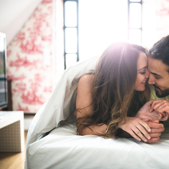 Couple-in-Bed-Enjoying-Time-Together