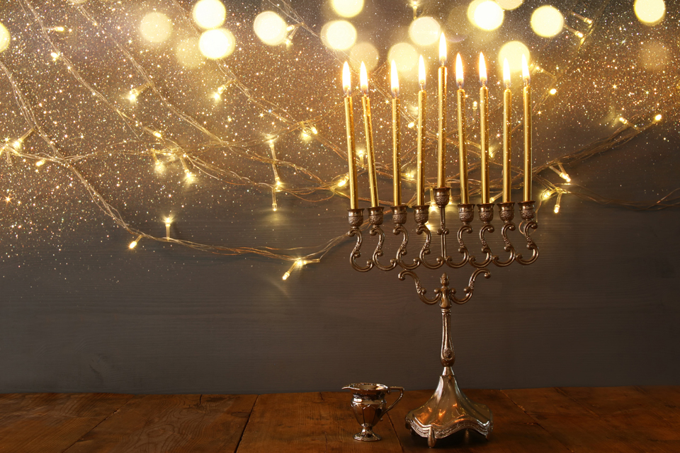 a golden menorah with gold lights around it