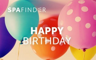spafinder gift card that reads happy birthday with balloons in the background
