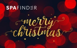 spafinder gift card that reads merry christmas with red orbs as background