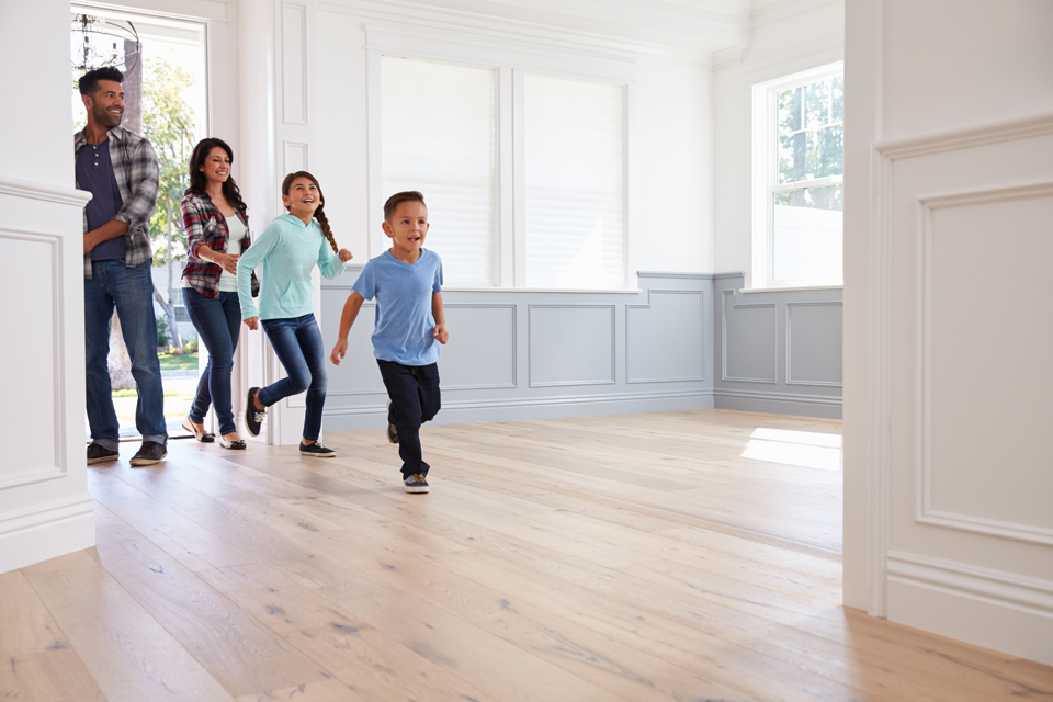 family walking into their new home