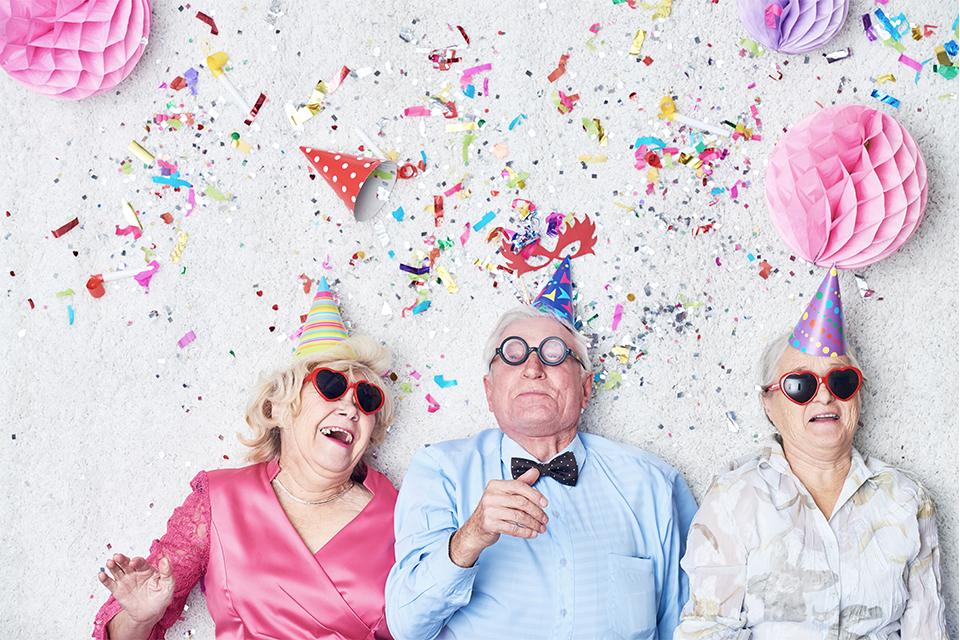 three elderly people celebrating new year's eve