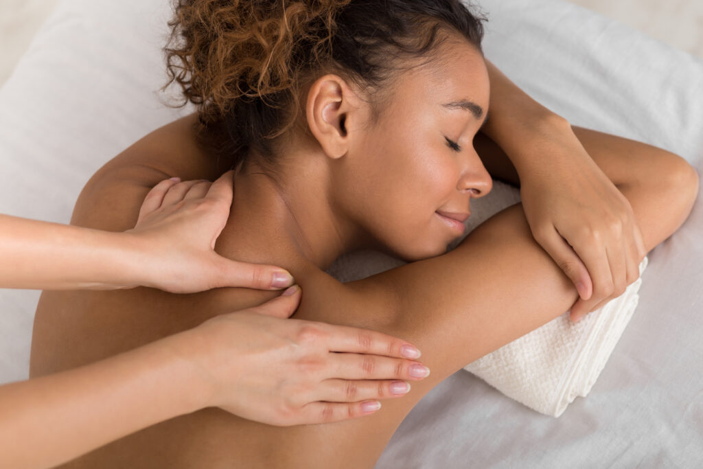 African-american-woman-enjoying-shoulder-massage-in-spa